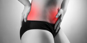 Dor nas costas e estômago inchado: causas