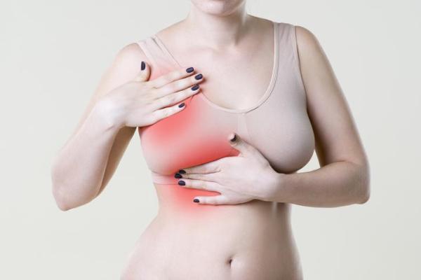 Seios doloridos sem menstruação: causas e tratamento - Mastite